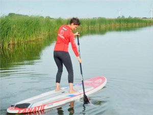 Paddling through the water on a SUP